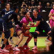 10 February 2018: The San Diego State Aztecs women's basketball team hosts Nevada on Play4Kay day at Viejas Arena. San Diego State Aztecs guard Te'a Adams (5) fights for a rebound against two Nevada defenders in the second half. The Aztecs beat the Wolfpack 75-72. <br /> More game action at www.sdsuaztecphotos.com