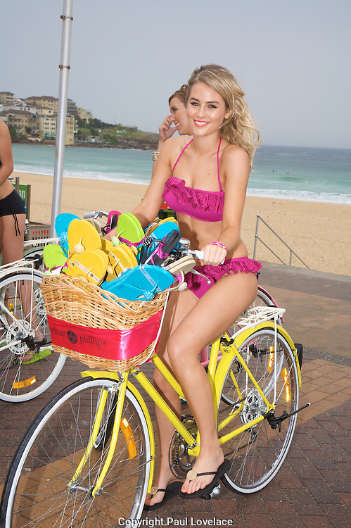Models launch Lindsay Phillips Switchflops on Bondi Beach today. Lindsay Phillips is a dynamic 25 year old entrepreneur who has turned a high school art project she completed when she was 16 into a $30 million global brand..Paul Lovelace Photography.15.10.10 . An instant sale option is available where a price can be agreed on image useage size. Please contact me if this option is preferred.