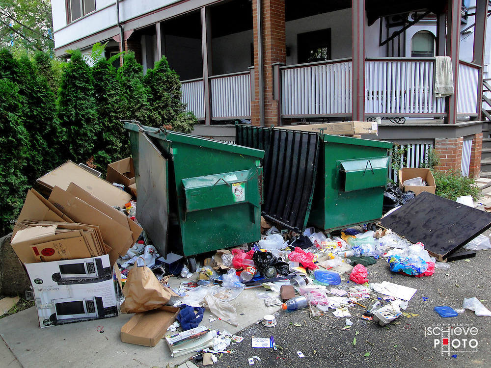 Trash piles up outside of a Madison, Wisconsin apartment building.