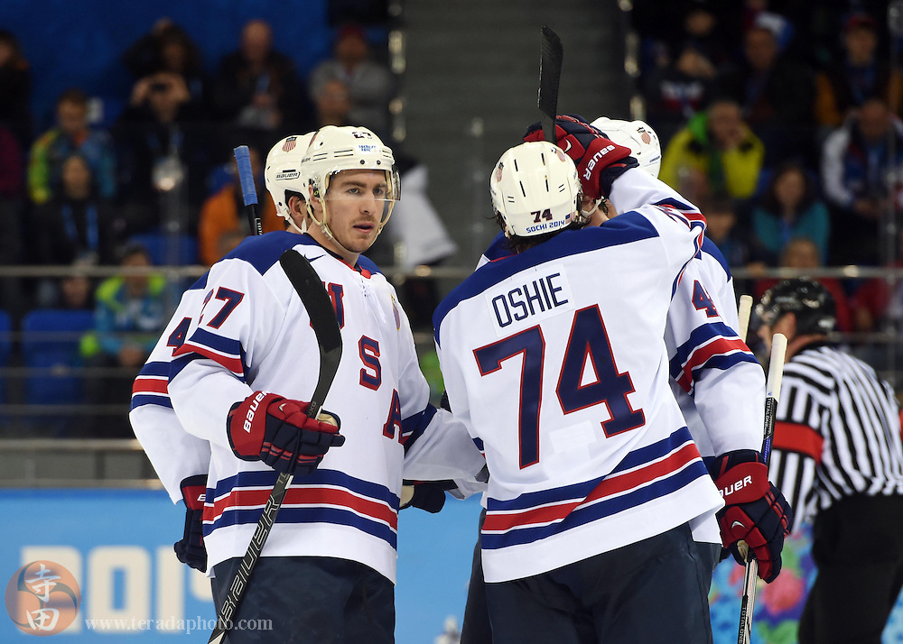 Feb 16, 2014; Sochi, RUSSIA; USA defenseman Ryan McDonagh (27) is congratulated by teammates including T.J. Oshie (74) after scoring a goal in the second period of a men's ice hockey preliminary round game against Slovenia during the Sochi 2014 Olympic Winter Games at Shayba Arena.