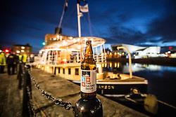 "© Licensed to London News Pictures. 04/05/2016. Birkenhead UK. Picture shows the Daniel Adamson beer brewed to celebrate the renovation of the Daniel Adamson by Titanic brewery. The Daniel Adamson steam boat has been bought back to operational service after a £5M restoration. The coal fired steam tug is the last surviving steam powered tug built on the Mersey and is believed to be the oldest operational Mersey built ship in the world. The ""Danny"" (originally named the Ralph Brocklebank) was built at Camel Laird ship yard in Birkenhead & launched in 1903. She worked the canal's & carried passengers across the Mersey & during WW1 had a stint working for the Royal Navy in Liverpool. The ""Danny"" was refitted in the 30's in an art deco style. Withdrawn from service in 1984 by 2014 she was due for scrapping until Mersey tug skipper Dan Cross bought her for £1 and the campaign to save her was underway. Photo credit: Andrew McCaren/LNP ** More information available here http://tinyurl.com/jsucxaq **"