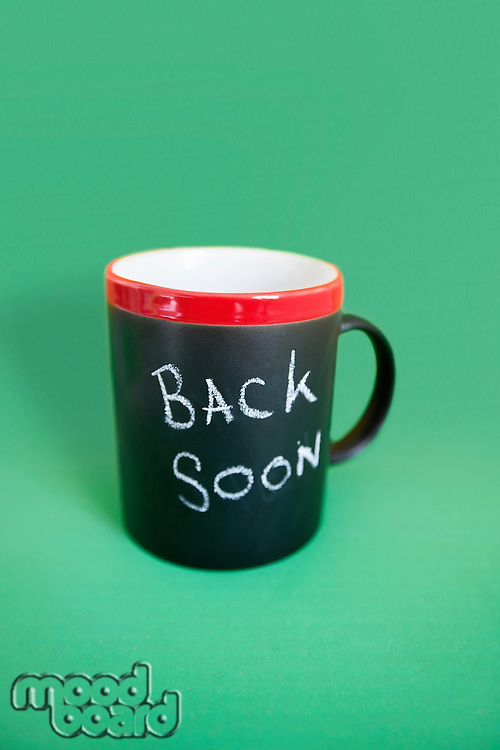 Coffee mug with text over colored background