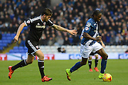 Birmingham City striker Clayton Donaldson gets away from Brentford defender Harlee Dean during the Sky Bet Championship match between Birmingham City and Brentford at St Andrews, Birmingham, England on 2 January 2016. Photo by Alan Franklin.