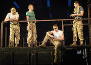 Black Watch <br /> National Theatre of Scotland<br /> written by Gregory Burke and directed by John Tiffany<br /> at The Barbican Theatre, London, Great Britain <br /> press photocall <br /> 26th November 2010 <br /> <br /> Jack Lowden (as Cammy)<br /> and ensemble