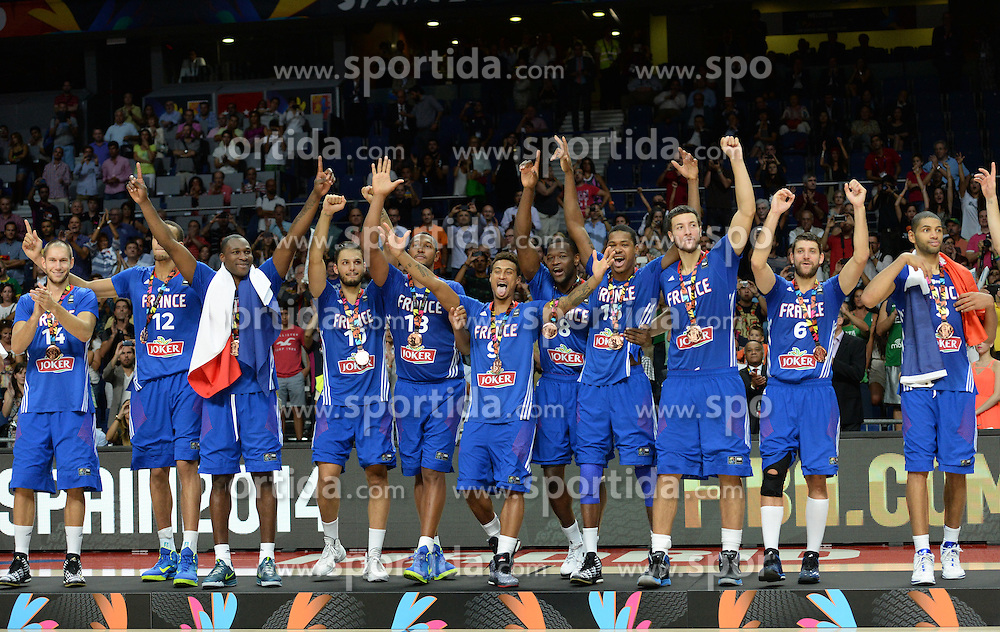 Players of France celebrate after winning bronze medal during the 2014 FIBA World Basketball Championship Third Place match between France and Lithuania at the Palacio de los Deportes, on September 13, 2014 in Madrid, Spain. Photo by Tom Luksys  / Sportida.com <br /> ONLY FOR Slovenia, France