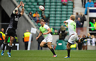 LONDON, ENGLAND - Sunday 11 May 2014, D J Forbes of New Zealand blocks a pass from Philip Snyman to Kwagga Smith of South Africa during the Cup quarter final match between South Africa and New Zealand at the Marriott London Sevens rugby tournament being held at Twickenham Rugby Stadium in London as part of the HSBC Sevens World Series.<br /> Photo by Roger Sedres/ImageSA