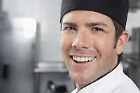 Male chef smiling close-up portrait