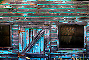 An old weathered barn in northern Utah shows the remnants of aqua-colored paint. Colin Braley / Wild West Stock