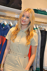 LAURA WHITMORE at a party to celebratethe opening of the Lacoste Flagship Store at 44 Brompton Road, Knightsbridge, London on 20th June 2012.