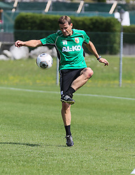 14.07.2013, Walchsee, AUT, FC Augsburg, Trainingslager, im Bild Fussball-Tennis am ersten Trainingstag, am Ball Wolfgang BELLER (Co-Trainer FC Augsburg) // during a trainings session of German 1st Bundesliga club FC Augsburg at their training camp in Walchsee, Austria on 2013/07/14. EXPA Pictures &copy; 2013, PhotoCredit: EXPA/ Eibner/ Klaus Rainer Krieger<br /> <br /> ***** ATTENTION - OUT OF GER *****