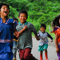 Town, of Boquete, Province of Chiriqui, country of Panama. .Ngobe indigenous kids bring their joy to the narrow roads of the surrounding hills.  While their parents work the land, the children can always be found playing by the road.
