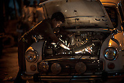 Man Repairing a Car by Torchlight - Chennai, India
