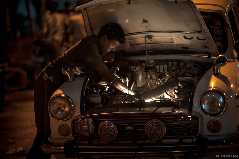 Man Repairing a Car by Torchlight - Chennai, India