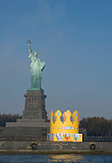 A 60-foot Burger King crown, which set a Guinness World Record, is unveiled in front of the Statue of Liberty to launch the new BK CROWN Program for Kids, Monday, Nov. 7, 2011, in New York.  The BK CROWN program includes a fund to support charities involved in fostering education and protecting the environment and wildlife.  Burger King Corp. also donated $125,000 towards the restoration of the Statue of Liberty in honor of her 125th birthday.  (Diane Bondareff/AP Images for Burger King Corp.)