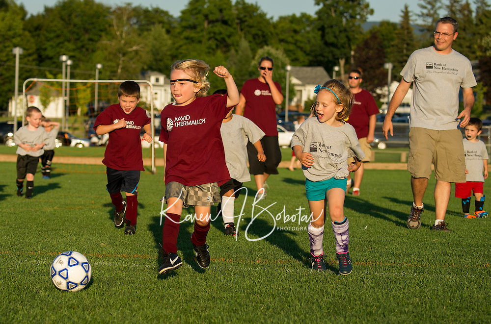 Jeffrey Joyce of Aavid Thermalloy's U6 takes a shot to the goal during Laconia Youth Soccer Wednesday evening at Opechee Park.  (Karen Bobotas/for the Laconia Daily Sun)