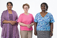 Multiracial group of older women smiling,