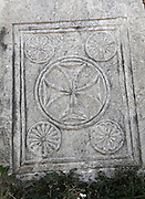 "Decorative Christian carving showing a large cross and smaller flowers enclosed in circles within a rectangular border, from the nave of the Basilica of St John, built 536-565 AD under Emperor Justinian on the site of the apostle's tomb, Ephesus, Izmir, Turkey. St John the Evangelist spent his last years in Ephesus and died here. In the 4th century a church was erected over his tomb but in the 6th century Justinian ordered the construction of a large, 6-domed basilica built of stone and brick with marble columns in a Greek cross plan, the ruins of which we see today. The church measures 130x56m and was an important Christian pilgrimage site, attaining the status of ""Church of the Cross"". Originally, the church interior would have been covered with frescoes, and the vaults with mosaics. An earthquake in the 14th century destroyed most of the building. Ephesus was an ancient Greek city founded in the 10th century BC, and later a major Roman city, on the Ionian coast near present day Selcuk. Picture by Manuel Cohen"