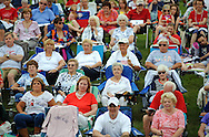 The crowd listens to performances during the 9th Annual Patriotic Concert featuring the Verdi Band at Saint Bede the Venerable Friday July 3, 2015 in Holland, Pennsylvania. (Photo by William Thomas Cain)