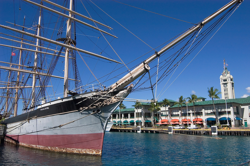 "Historic ship ""Falls of Clyde"" at the Hawaii Maritime Center, with Aloha Tower behind; Honolulu harbor, Oahu, Hawaii."