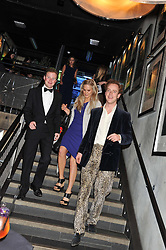 Left to right, GUY PELLY, LADY PHILIPPA HOWARD and TOM INSKIP at the Wild for WSPA dinner in aid of the charity World Society for the Protection of Animals held at Under The Bridge, Stamford Bridge, Fulham Road, London on 23rd February 2012.