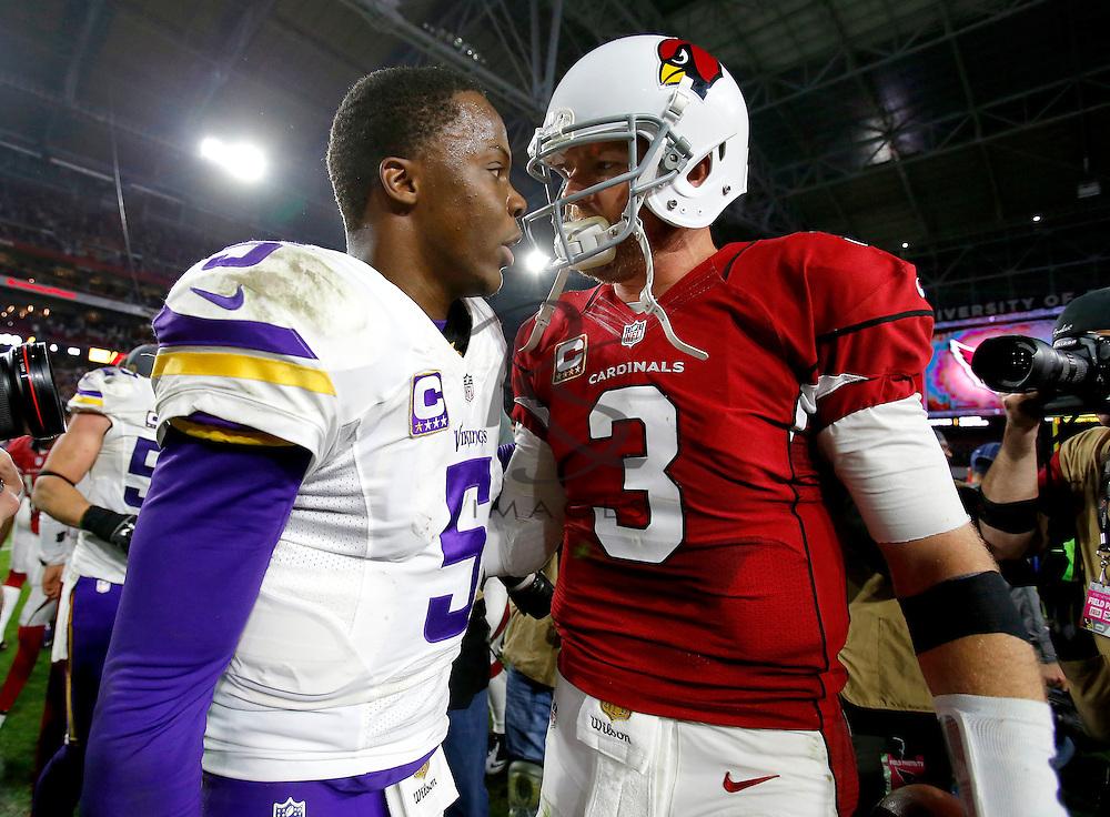 Minnesota Vikings quarterback Teddy Bridgewater (5) greets Arizona Cardinals quarterback Carson Palmer (3) after an NFL football game, Thursday, Dec. 10, 2015, in Glendale, Ariz. The Cardinals won 23-20. (AP Photo/Rick Scuteri)