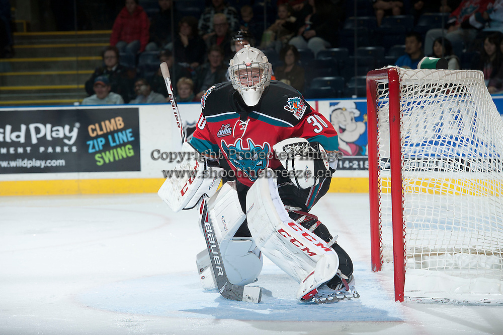KELOWNA, CANADA - OCTOBER 11:  Jordon Cooke #30 of the Kelowna Rockets defends the net against the Seattle Thunderbirds on October 11, 2013 at Prospera Place in Kelowna, British Columbia, Canada (Photo by Marissa Baecker/Shoot the Breeze) *** Local Caption ***