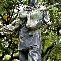 God of War Statue at Hama-rikyu Gardens in Tokyo, Japan<br /> According to Shintō beliefs, Nigihayahinomikoto bequeathed to his son the Ten Sacred Auspicious Treasures. One of them was the Kusanagi Sword. This bronze statue of Umashimadenomikoto shows him holding the weapon in his role as god of war. The sculpture was created by Akira Sano and stands in the Hama-rikyu Gardens.
