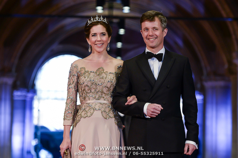 Crown Prince Frederik of Denmark, right, and his wife Princess Mary, left, arrive for a dinner with members of the royal family and guests, at the invitation of Queen Beatrix, at the Rijksmuseum in Amsterdam, The Netherlands, on Monday night, April 29, 2013. HANDOUT/ROBIN UTRECHT