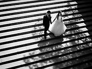 Wedding couple on the stairs of Bethesda Terrace in Central Park