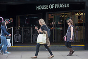 On the day that closures of many branches and the loss of jobs, shoppers are outside The House of Fraser department store on Oxford Street which has been in business for 81 years, on 7th June 2018, in London, England. House of Fraser is to close 31 of its 59 shops, affecting 6,000 jobs, as part of a financial rescue deal. If the plan is approved, 2,000 House of Fraser jobs will go, along with 4,000 brand and concession roles. The stores scheduled for closure, which include its flagship London Oxford Street store, will stay open until early 2019.