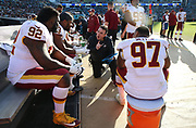 Dec 16, 2018; Jacksonville, FL, USA; Washington Redskins defensive line coach Jim Tomsula talks with his players during an NFL game at TIAA Bank Field against the Jacksonville Jaguars. The Redskins beat the Jaguars 16-13. (Steve Jacobson/Image of Sport)