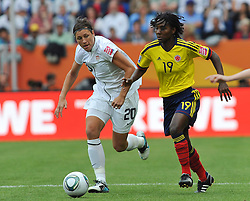 02.07.2011, Rhein-Neckar-Arena, Sinsheim, GER, FIFA Women Worldcup 2011, GRUPPE C, USA (USA) vs. Kolumbien (COL) , im Bild Abby WAMBACH (USA #20, Boca Raton magicJack)  und Fatima MONTANO (COL #19, Aguila Roja)  // during the FIFA Women Worldcup 2011, Pool C, USA vs. Columbia on 2011/07/02, Rhein-Neckar-Arena, Sinsheim, Germany. EXPA Pictures © 2011, PhotoCredit: EXPA/ nph/  Roth       ****** out of GER / CRO  / BEL ******