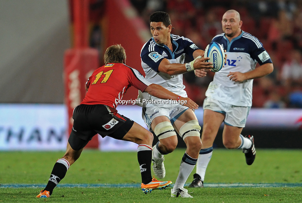 JOHANNESBURG, South Africa, 04 March 2011. Kurtis Haiu of the Blues prepares to offload with Michael Killian of the Lions making the tackle during the Super15 Rugby match between the Lions and the Blues at Coca-Cola Park in Johannesburg, South Africa on 04 March 2011. <br /> Photographer : Anton de Villiers / SASPA / PHOTOSPORT
