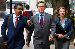 © Licensed to London News Pictures. 09/06/2016. London, UK. JOHN LETTS, (centre) and SALLY LANE (right) arrive at Westminster Magistrates Court in London where they face terrorism charges. John Letts and Sally Lane are accused of trying to send money to their son, Jack Letts, AKA 'Jihadi Jack' who is suspected of supporting ISIS after he fled to Syria in 2014 aged 18.  Photo credit: Ben Cawthra/LNP