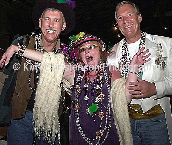 KIM CHRISTENSEN/For The Daily News.Krewe of Aquarius 1 KC.Fred Josephson of Galveston, left, Karen and Walter Josephson all enjoy the Mystic Krewe of Aquarius Barn Bash 2000 Friday night in Galveston.