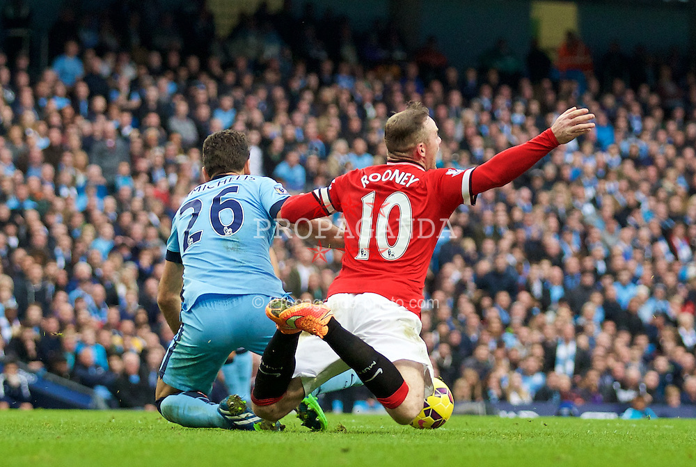 MANCHESTER, ENGLAND - Sunday, November 2, 2014: Manchester United's Wayne Rooney is brought down by Manchester City's Martin Demichelis during the Premier League match at the City of Manchester Stadium. (Pic by David Rawcliffe/Propaganda)