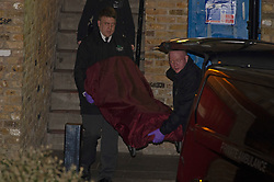 © Licensed to London News Pictures. 27/03/2019. West Norwood,UK. Body being taken away from the scene, A teenager has been shot dead on the Hainthorpe Estate, West Norwood,London. Police  are on scene and cordons in place, the victim was pronouced dead at the scene. Photo credit: Grant Falvey/LNP