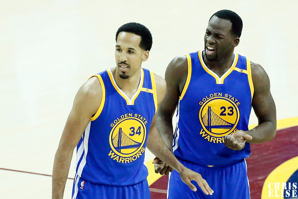 09 June 2017: Golden State Warriors guard Shaun Livingston (34) is seen next to Golden State Warriors forward Draymond Green (23) during the Cleveland Cavaliers 137-11 victory over the Golden State Warriors, in game 4 of the 2017 NBA Finals, at  the Quicken Loans Arena, Cleveland, Ohio, USA.