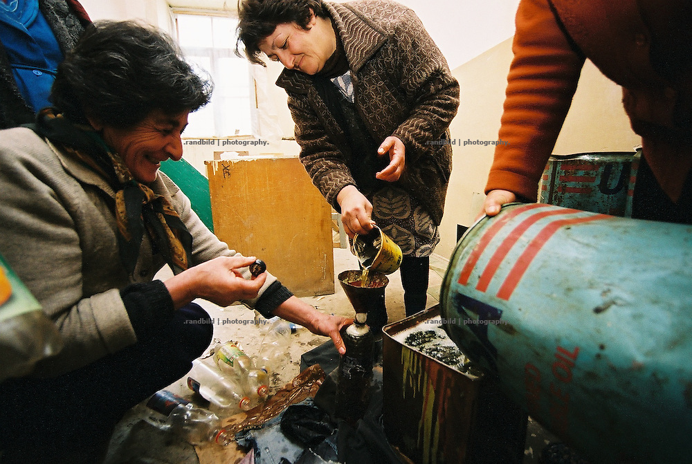 To heat up cold classrooms in Winter caretakers prepare kerosene bottles in the morning to fuel stoves with it. This school in the west armenian  village of Hoktember is not insulated well, due to the lack of budget. Simple stoves make sure to warm up the rooms for a while.