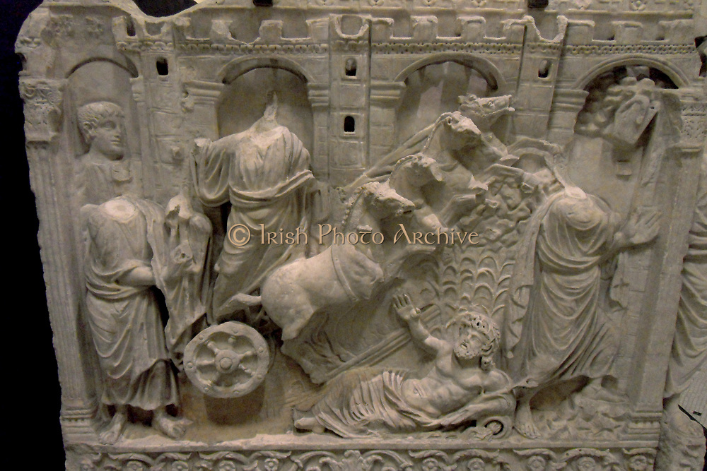 Sculpted relief of a scene from the Old Testament. Made from Marble. The design is quite reminiscent of Roman iconography. Four horses rear up from pulling their chariot in front of a man on the road.