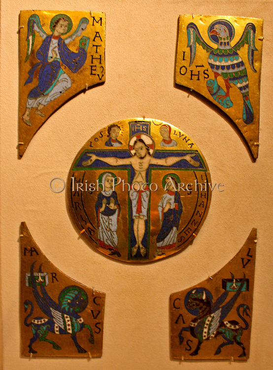 The Crucifixion with Symbols of the Evengelists. Champleve and cloisonne enamel on gilded copper.  French, Conques. Made about 1100.