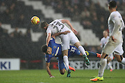 AFC Wimbledon striker Lyle Taylor (33) and Milton Keynes Dons defender Paul Downing (23) tangle during the EFL Sky Bet League 1 match between Milton Keynes Dons and AFC Wimbledon at stadium:mk, Milton Keynes, England on 10 December 2016.