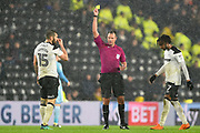 Referee James Linington shows a yellow card to Derby County midfielder Bradley Johnson (15) during the EFL Sky Bet Championship match between Derby County and Sunderland at the Pride Park, Derby, England on 30 March 2018. Picture by Jon Hobley.