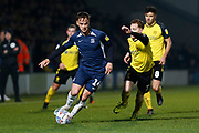 Steven Quinn chases Brandon Goodship during the EFL Sky Bet League 1 match between Burton Albion and Southend United at the Pirelli Stadium, Burton upon Trent, England on 3 December 2019.