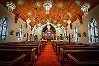 Interior view of historic St. Mary the Virgin Anglican Church. This church, said to be the oldest church in The Bahamas, is thought to have been built by the Spanish in the 1600's.