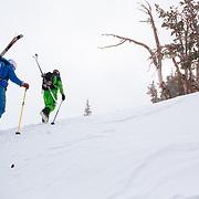 Jess McMillan (behind) and Tanner Flanagan hike towards the backcountry near Jackson Hole Mountain Resort.