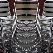 Photographic series of digital computer art from an image of stack of chairs.<br /> <br /> Two or more layers were used to enhance, alter, manipulate the image, creating an abstract surrealistic mirrored symmetry.