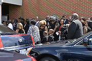 """5/30/15 Indianola  Friends,family and fans arrive at B B King's funeral service.  """"See That My Grave Is Kept Clean"""" one of BB Kings famous songs forecast his funeral procession complete with two white horses and a black horse flanked with two signed Gibson guitars. Fans lined the street to see B.B. Kings final homecoming and pay their respect. Photo ©Suzi Altman"""