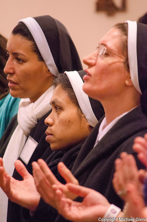 Jan. 25, 2014 Piscataway USA // Nuns hold their palms facing upward as they pray during the closing mass at St. John Neumann Pastoral Center during the New Jersey Catholic Young Adult Conference