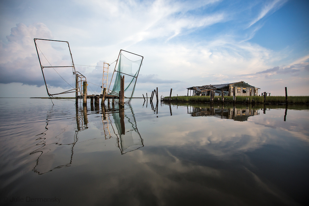 An  abandoned  fishing camp in the waters off Isle de Jean Charles deep in the bayous of Terrebonne Parish in South Louisiana. The marsh land is disappearing at a fast clip due to coastal erosion.
